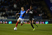 Portsmouth's Ross McCrorie and Peterborough's Ricky-Jade Jones during the EFL Sky Bet League 1 match between Portsmouth and Peterborough United at Fratton Park, Portsmouth, England on 7 December 2019.