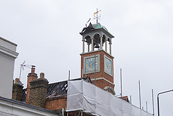 Scaffolding surrounds the building after lightning struck the Grade II listed 1890s old fire station clock tower in Wimbledon Village during a storm, starting a fire in the roof on Thursday July 25th. Wimbledon, July 30 2019.
