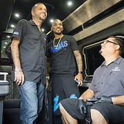 DORAL, FLORIDA, DECEMBER 11, 2015<br /> Alex Vega, left, owner of The Auto Firm, a South Florida car customizing and restoring shop which has a vast clientele of professional athletes and entertainers,  shows Atlanta rapper Peeto the Plug a customized Mercedes Benz limo van. Sitting is electronics specialist Jose Oyuela. The van sells for $175.000.<br /> (Photo by Angel Valentin/Freelance)
