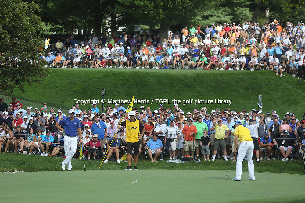 Henrik STENSON (SWE) looks on as Jonas BLIXT (SWE) putts at 5th hole during fourth round US PGA Championship 2013,Oak Hill CC,