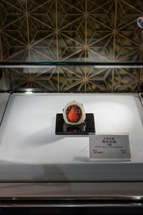 """Tokyo, January 19 2016 - Ichigo Daifuku (strawberry stuffed in a glutinos rice cake) on display at Mitsukoshi Nihonbashi department store. In Japanese department stores, the basement floor is a foodstuff market area. These areas go by the nickname """"depachika"""" (a combination of """"depato"""", meaning department store, and """"chika"""", meaning basement)."""