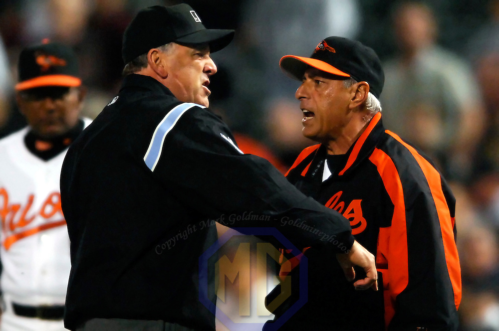 14 June 2007:  First base umpire Ed Montague (L) throws out Baltimore Orioles manager Sam Perlozzo in the 8th inning after Perlozzo came out of the dugout to argue a strike call against batter Jay Payton on a bunt attempt.  Perlozzo was ejected for the second time in a week as the Nationals defeated the Orioles 3-1 in inter-league play to sweep the three game series at Camden Yards in Baltimore, MD.   ****For Editorial Use Only****