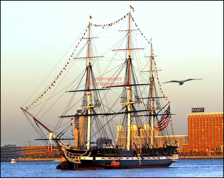 (11/08/2002-Boston, MA) The Old and The new......The U.S.S Constitution moves toward the bow of the U.S.S Preble tonite in anticipation of tommorrows christening ceremonies at World trade ctr's Pier4. (110802constitutionmg-Staff photo: Mark Garfinkel.Saved SAT/photo 1)