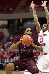 28 January 2015:   Gavin Thurman grimaces with his eyes shut as he anticipates contact with Deontae Hawkins during an NCAA MVC (Missouri Valley Conference) men's basketball game between the Missouri State Bears and the Illinois State Redbirds at Redbird Arena in Normal Illinois