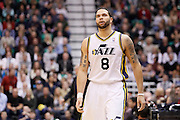 Jazz point guard Deron Williams looks up at the clock during an NBA basketball game in Salt Lake City, Wednesday Jan. 26, 2011. (AP Photo/Colin E Braley)