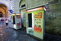 Two photo booths on the side of the stret in Florence Italy