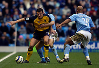 Photo: Jed Wee.<br />Manchester City v Wigan Athletic. The Barclays Premiership. 18/03/2006.<br /><br />Wigan's Lee McCulloch (L) is subject of a close examination from Manchester City's Danny Mills.