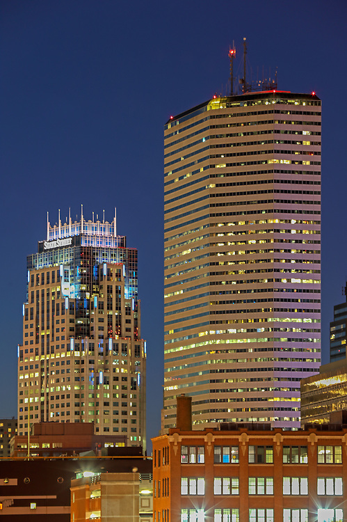 Boston skyline photography showing the Boston State Street Corporation and the One Financial Center at Dewey Square on a magnificent night at twilight. This Boston skyline photo at the blue hour is available as museum quality photography prints, canvas prints, acrylic prints or metal prints. Fine art prints may be framed and matted to the individual liking and decorating needs:<br />