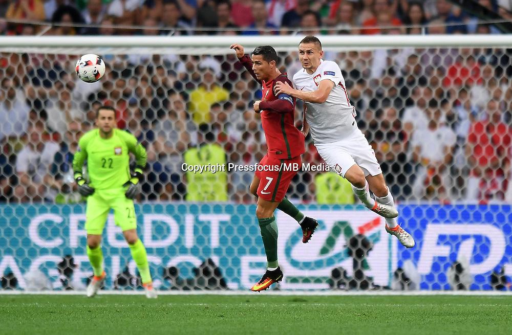 2016.06.30 Marsylia Marseille<br /> Pilka nozna Euro 2016 mecz cwiercfinal <br /> Polska - Portugalia <br /> N/z Cristiano Ronaldo, Artur Jedrzejczyk<br /> Foto Lukasz Laskowski / PressFocus<br /> <br /> 2016.06.30 Marsylia Marseille<br /> Football UEFA Euro 2016 quarter finals<br /> Poland and Portugal<br /> Cristiano Ronaldo, Artur Jedrzejczyk<br /> Credit: Lukasz Laskowski / PressFocus