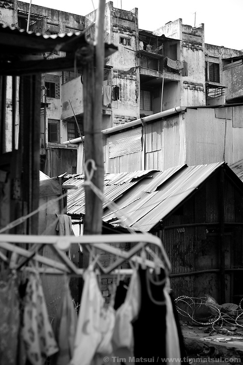 "Scenes from a slum where the agency ""Acting for Women in Distressing Situations"" (AFESIP) conducts outreach and provides services in Phnom Penh, Cambodia. The permanent structure, a decaying four story building known simply as 'The Building', was built in the 1960's as transitional housing and now hosts a shantytown where many of the city's poor live, including many prostitutes, and is believed to have the highest rate of HIV infection in the city. AFESIP hands out free condoms, instructs prostitutes on HIV prevention, and conducts outreach in case the prostitutes need medical services, choose to leave their profession, or can report on cases of sex trafficking. AFESIP offers housing, education, training, and counseling for women who are victims of sex trafficking, worked as prostitutes, or are escaping domestic violence. Founded by Somaly Mam, who herself was once a prostitute and victim of trafficking and domestic abuse, AFESIP has three facilities in Cambodia and works with other NGO's to provide long term care for the women."