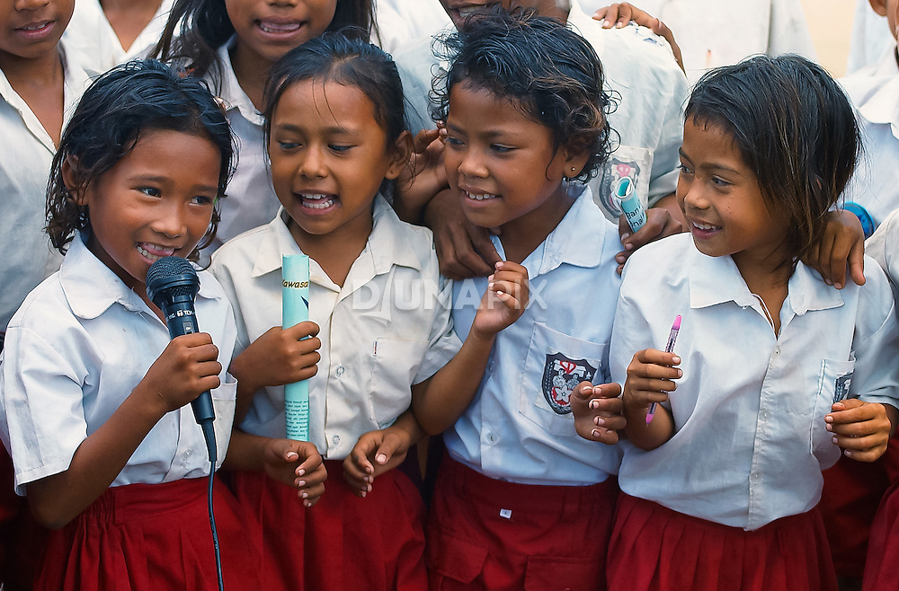 Young girls sing during a RARE Conservation Pride Campaign sing-along, Komodo Village, Komodo National Park
