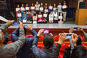 Parents take photos of the participants during the 1st Annual Spelling Bee at Rancho Middle School in Milpitas, California, on December 9, 2015. (Stan Olszewski/SOSKIphoto)