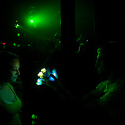 March 28, 2012 - New York, NY : Fans dance with twirling colored lights as British dubstep music producer  (DJ) 'Plastician'  performs at the Best Buy Theater in Manhattan on Wednesday evening. CREDIT: Karsten Moran for The New York Times