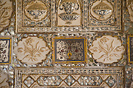 An ornate panel at the Sheesh Mahal, hall of mirrors at the Amber Fort in<br /> Jaipur, Rajasthan, India
