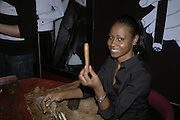 Lady from Cuba rolling cigard during the party. Drinks party to launch a new Thomas Pink shirt called The Mogul which has a pocket which houses one's cigar. Hostyed by the Spectator and Thomas Pink. Floridita. Wardour St. London. 1 November 2006. -DO NOT ARCHIVE-© Copyright Photograph by Dafydd Jones 66 Stockwell Park Rd. London SW9 0DA Tel 020 7733 0108 www.dafjones.com