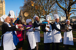 London, February 17th 2015. Members of Parliament put their dignity aside for a bit of fun as they compete in the annual Parliamentary Pancake Race in Victoria Tower Gardens adjacent to the House of Lords.  PICTURED: Left to right, Andrew Rosindell, Lord Redesdale, ITV News Presenter and official race starter Charlene White, Stephen Pound, Nick DeBois, Lord Kennedy, David Burrowes and Sir David Amess practice tossing their pancakes.