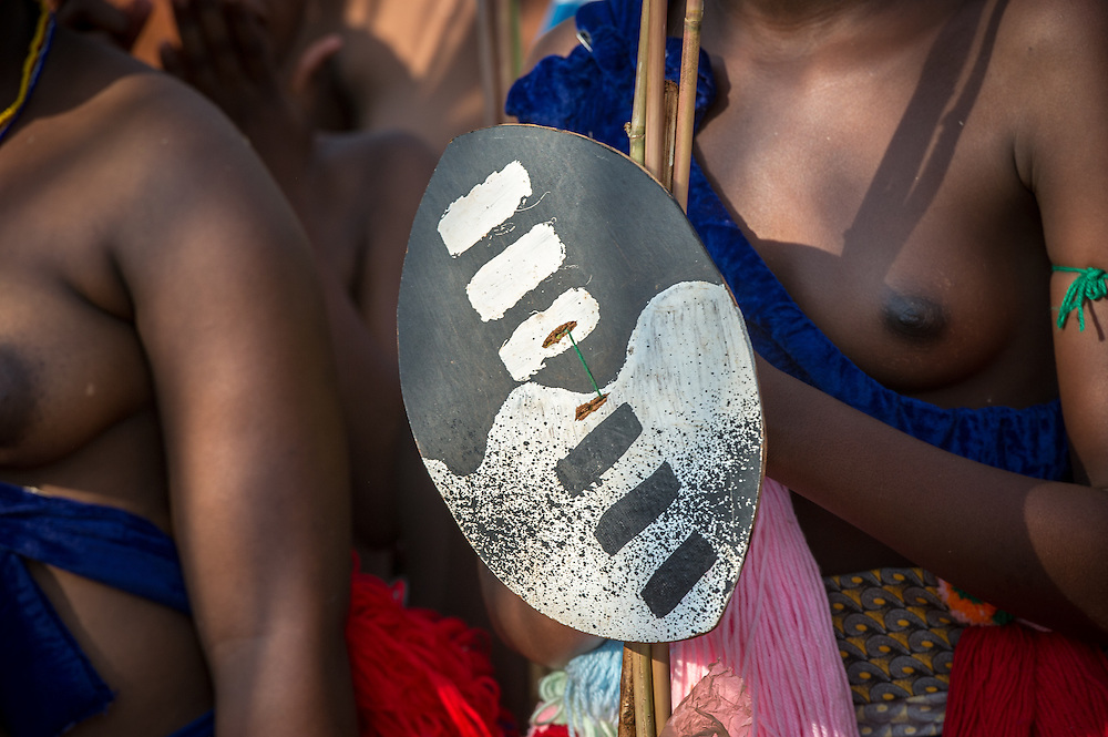 Ludzidzini, Swaziland, Africa - Annual Umhlanga, or reed dance ceremony, in which up to 100,000 young Swazi women gather to celebrate their virginity and honor the queen mother during the 8 day long event.<br /> Ceremonial shield
