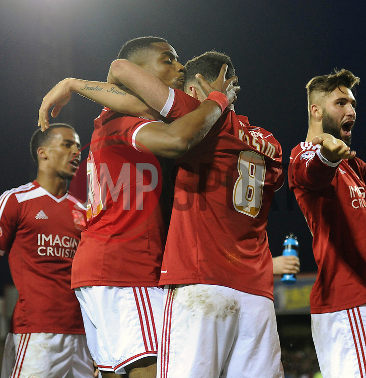 Swindon Town's Jonathan Obika celebrates his goal with Swindon Town's Yaser Kasim - Photo mandatory by-line: Dougie Allward/JMP - Mobile: 07966 386802 - 11/05/2015 - SPORT - Football - Swindon - County Ground - Swindon Town v Sheffield United - Sky Bet League One - Play-Off