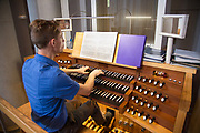 Nathan Sumrall plays the organ before a special mass for north shore alumni of Loyola University at St. Joseph Abbey in St. Benedict, Louisiana on July 30, 2017; photo ©2017, George H. Long