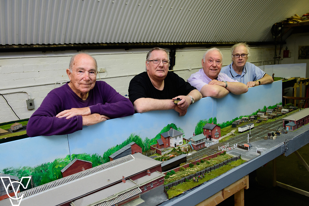 INSIGHT MAGAZINE: Bridlington Model Railway Society are based in Station Road, Bridlington, in a railway arch unit owned by Network Rail.  Pictured is, from left, Trevor Pritchard, Graham Wilson (Bridlington Model Railway Society secretary), Harold Bellhouse (Bridlington Model Railway Society chairman) and Neil Porter with the model of Filey station.<br /> <br /> Picture: Chris Vaughan Photography<br /> Date: May 31, 2017