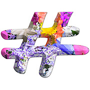 The hashtag # symbol Part of a set of letters, Numbers and symbols of 3D Alphabet made with colourful floral images on white background