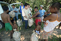 Nukak-Maku Indians receive aid packages of food at their camp just outside of San Jose de Guaviare on November 20, 2006. The Indians at the camp are now part of Colombia?s displaced community. With limited exposure to the western world they have left behind their nomadic traditions in the Colombian jungle in a large part due to fear of the FARC, the leftist rebels who control much of the jungle that was traditionally inhabited by the Indians and that is now being used by the FARC to produce cocaine which finances their war. (Photo/Scott Dalton)