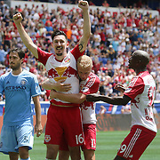 HARRISON, NEW JERSEY- JULY 24: Sacha Kljestan #16 of New York Red Bulls is congratulated by teammates Mike Grella #13 of New York Red Bulls and Bradley Wright-Phillips #99 of New York Red Bulls after beating Josh Saunders #12 of New York City FC from the penalty spot for the New York Red Bulls third goal during the New York Red Bulls Vs New York City FC MLS regular season match at Red Bull Arena, Harrison, New Jersey on July 24, 2016 in Harrison, New Jersey. (Photo by Tim Clayton/Corbis via Getty Images)