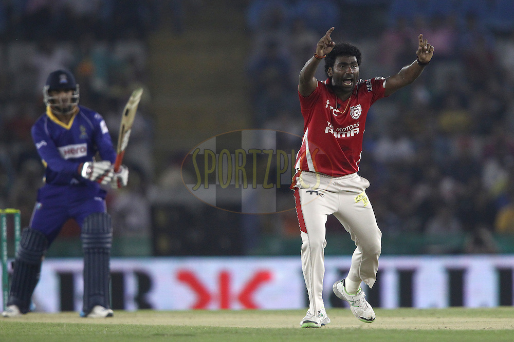 Parvinder Awana of the Kings XI Punjab appeals successfully for LBW to get William Perkins of the Barbados Tridents wicket during match 5 of the Oppo Champions League Twenty20 between the Kings XI Punjab and the Barbados Tridents held at the Punjab Cricket Association Stadium, Mohali, India on the 20th September 2014<br /> <br /> Photo by:  Shaun Roy / Sportzpics/ CLT20<br /> <br /> <br /> Image use is subject to the terms and conditions as laid out by the BCCI/ CLT20.  The terms and conditions can be downloaded here:<br /> <br /> http://sportzpics.photoshelter.com/gallery/CLT20-Image-Terms-and-Conditions-2014/G0000IfNJn535VPU/C0000QhhKadWcjYs