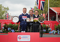 David Weir GBR and Manuela Schar SUI pose with their respective salvers with HRH Prince Henry of Wales (Prince Harry) following their wins in the Elite Wheelchair Races. The Virgin Money London Marathon, 23rd April 2017.<br /> <br /> Photo: Ben Queenborough for Virgin Money London Marathon<br /> <br /> For further information: media@londonmarathonevents.co.uk