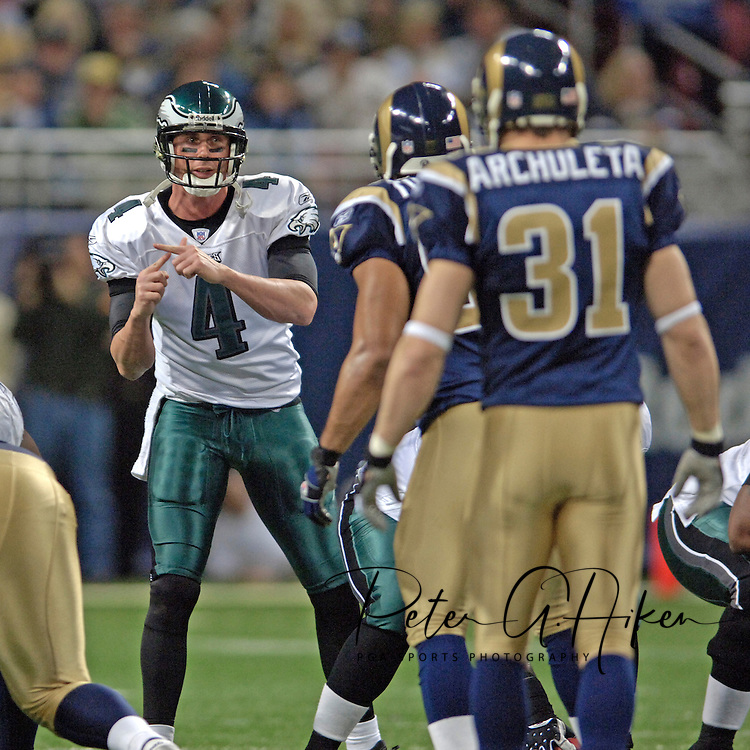 Philadelphia Eagles quarterback Mike McMahon (4) signals a play as St. Louis Rams Adam Archuleta (31) looks in, at the Edward Jones Dome in St. Louis, Missouri, December 18, 2005.  The Eagles beat the Rams 17-16.