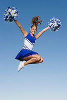 Cheerleader Jumping in Mid-Air