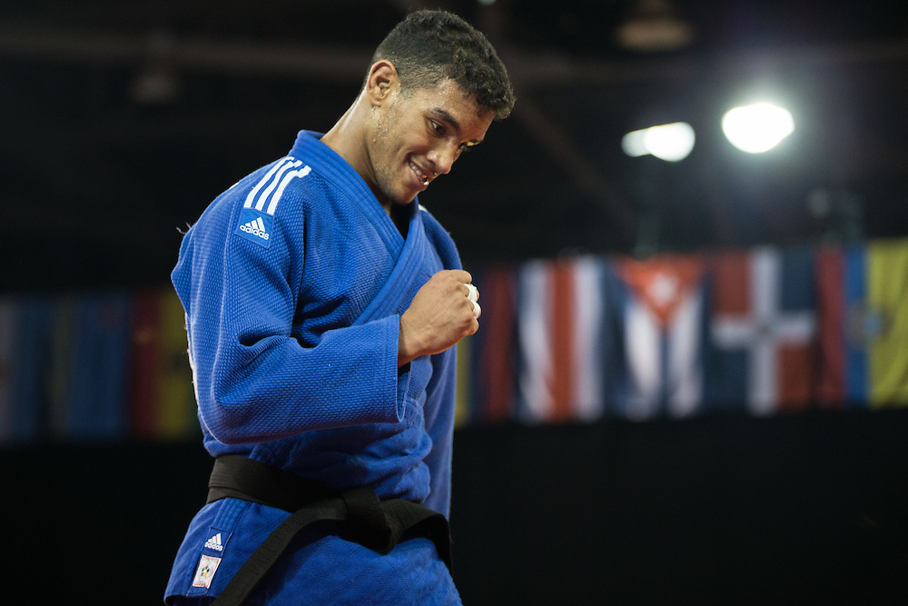 Gold medalist Magdeil Estrada of Cuba celebrates his victory over Alejandro Clara in the men's judo 73kg class at the 2015 Pan American Games in Toronto, Canada, July 12,  2015.   AFP PHOTO/GEOFF ROBINS