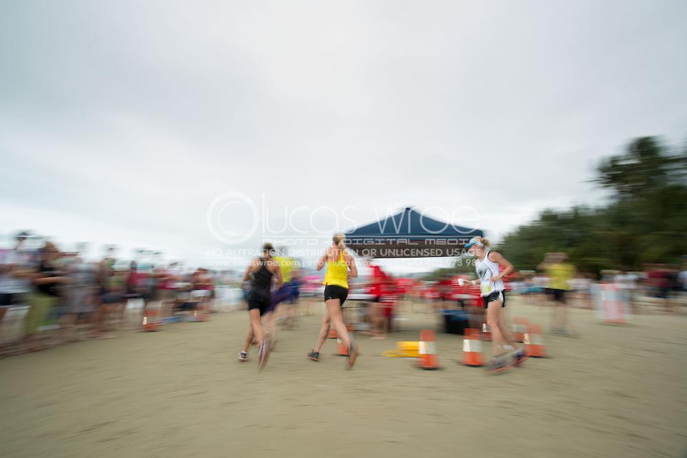 Age Group Competitors at the run turn-around, June 1, 2014 - TRIATHLON : Coral Coast 5150 Triathlon, Cairns Airport Adventure Festival, Four Mile Beach, Port Douglas, Queensland, Australia. Credit: Lucas Wroe