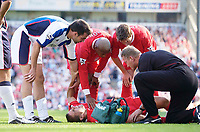 Photo. Jed Wee.<br /> Blackburn Rovers v Liverpool, FA Barclaycard Premiership, Ewood Park, Blackburn. 13/09/2003.<br /> Liverpool's Milan Baros lies in agony as team mates Harry Kewell (R) and El Hadji Diouf (C), as well as Blackburn's Marcus Babbel, himself on loan from Liverpool, show concern.