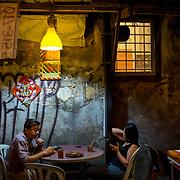 People having their dinner at a stall in Lorong Panggong in Kuala Lumpur on November 22, 2017.