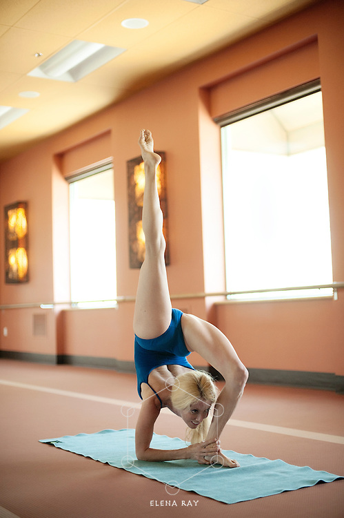 Woman practicing yoga. Kim Tang, Bikram yoga teacher in Johsua Tree, CA