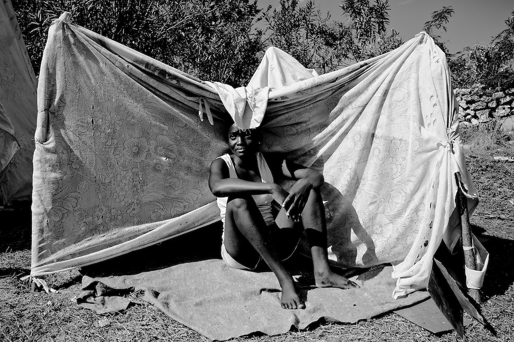 A girl sits outside her tent in a camp for those displaced by the recent earthquake in Petionville, outside Port-au-Prince, Haiti.