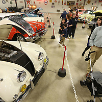 Museum goers walk past the 1955 Jaguar XK140 on display at the Tupelo Automobile Museum on its last day open to the public Sunday afternoon.