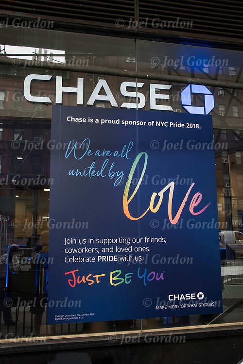 Corporate marketing directly directly to LGBT ( lesbians, gays,  bisexual and transgenders ) during  June,  Pride Month.<br /> <br /> Sign in window of Chase bank in Greenwich Village.<br /> <br /> The rainbow flag, sometimes called 'the freedom flag', a symbol of lesbian, gay, bisexual and transgender (LGBT) pride and diversity.