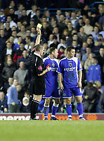 Photo: Andrew Unwin.<br />Leeds United v Cardiff City. Coca Cola Championship.<br />10/12/2005.<br />Cardiff's Kevin Cooper (C) is shown the yellow card by the referee, Mr G Salisbury (L).