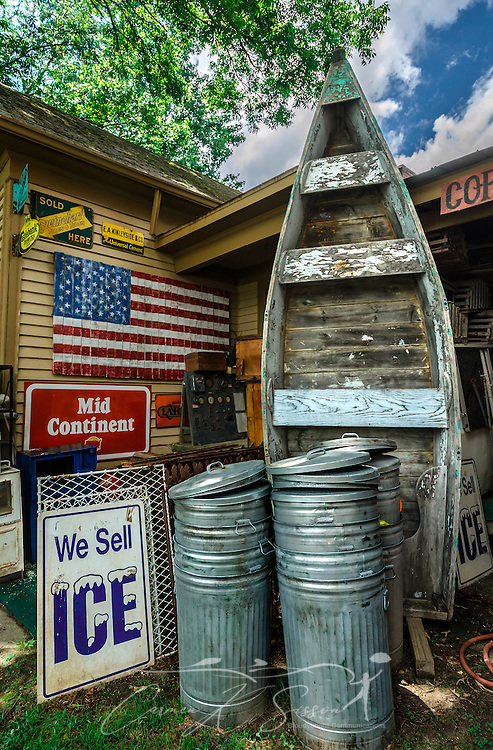 Vintage advertisements and other items are stacked stacked Biggar's Antiques in Chamblee, Georgia, June 10, 2014. The family-owned shop was founded in New York and supplies props for many of Hollywood's most popular movies. (Photo by Carmen K. Sisson/Cloudybright)