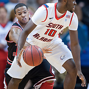 MOBILE, AL - DECEMBER 29:  Rakeem Dickerson #1 steals the ball from Wendell Wright #10 of the South Alabama Jaguars at USA Mitchell Center on December 29, 2012 in Mobile, Alabama. At halftime Arkansas State leads South Alabama 28-23. (Photo by Michael Chang/Getty Images) *** Local Caption *** Rakeem Dickerson;Wendell Wright