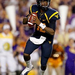Sep 25, 2010; Baton Rouge, LA, USA; West Virginia Mountaineers quarterback Geno Smith (12) looks to pass during the first half against the LSU Tigers at Tiger Stadium.  Mandatory Credit: Derick E. Hingle
