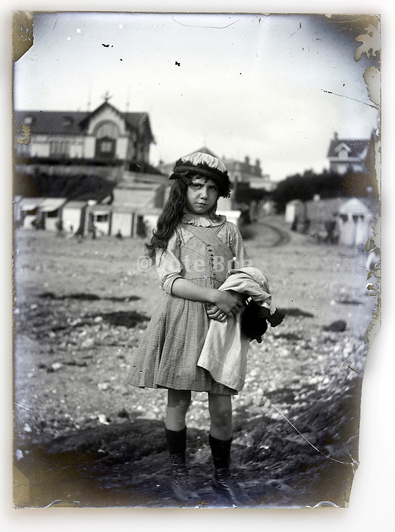 fading glass plate with young girl casual posing