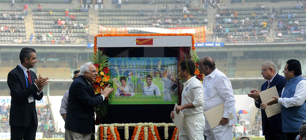 (L to R) Milind Deora MP, Kapil Sibbal Union law minister, Sachin Tendulkar of India,Sharad Pawar president MCA,  N Srinivasan president BCCI and Rajiv Shukla MP during a felicitation ceremony before the start of play on day one of the second Star Sports test match between India and The West Indies held at The Wankhede Stadium in Mumbai, India on the 14th November 2013<br /> <br /> This test match is the 200th test match for Sachin Tendulkar and his last for India.  After a career spanning more than 24yrs Sachin is retiring from cricket and this test match is his last appearance on the field of play.<br /> <br /> Photo by: Pal PIllai - BCCI - SPORTZPICS<br /> <br /> Use of this image is subject to the terms and conditions as outlined by the BCCI. These terms can be found by following this link:<br /> <br /> http://sportzpics.photoshelter.com/gallery/BCCI-Image-Terms/G0000ahUVIIEBQ84/C0000whs75.ajndY