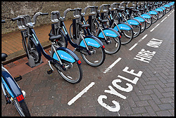 A row of Boris Bikes at a docking station in Wandsworth, South West London, United Kingdom. Friday, 13th December 2013. Picture by Andrew Parsons / i-Images