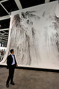HONG KONG - MARCH 13: A visitor looks at painting 'Beholding the Mountain with awe No. 1' by Xu Longsen in art fair Art Basel on its preview day on March 13, 2015 in Hong Kong, Hong Kong.  (Photo by Lucas Schifres/Getty Images)