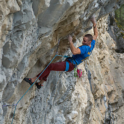 Sam Tucker leading the Illusionist, 5.14a at Planet X, Cougar Canyon, Canmore, Alberta