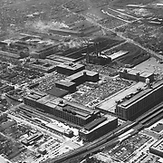 C. 1950 aerial of Studebaker's South Bend plant.  This images faces southwest, with South Bend's Union Station just visible on the right.  Studebaker's Body Plant (#84) and Administration Building are visible in the foreground, as well.