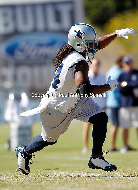 Dallas Cowboys running back Marion Barber (24) takes a handoff on a running play during NFL football training camp on Wednesday, August 18, 2010 in Oxnard, California. (©Paul Anthony Spinelli)